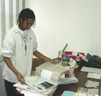 Nonhlanhla Mkhize, the Centre Manager goes through the news clipping archive
